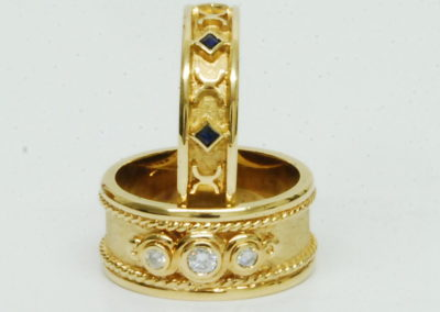 Many Etruscan style rings