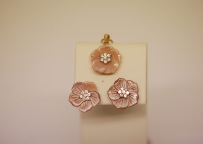 Pink mother of pearl and diamond earrings and pendant