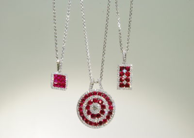 Selection of ruby and diamond pendants